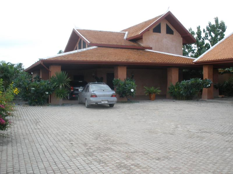 buy or sell Two storey house with surronding wall, big tropical garden and swiming pool  at