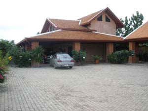 buy or sell Two storey house with surronding wall, big tropical garden and swiming pool